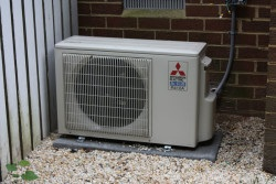 Mitsubishi ductless system outside compressor by Williamsburg HVAC